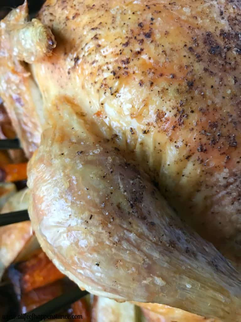 A close up of a roasted chicken leg.