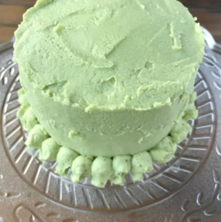 A mini smash cake that is healthy for babies birthday and made with only 7 ingredients. This cake is gluten free, grain free, dairy free and refined sugar free. Sweetened with honey and blueberry jam. It's topped with a creamy refined sugar free buttercream frosting that's colored with spinach juice. This cake follows the SCD diet and can be made Paleo by using a different frosting.