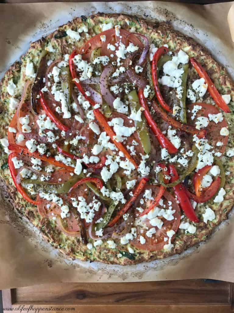 A healthy, low carb pizza crust made from zucchini, almond flour, eggs and oregano! Paleo, vegetarian, Whole 30 and SCD.