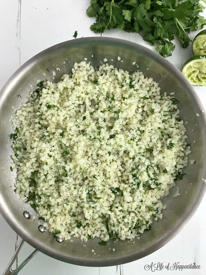 Overhead shot of a skillet filled with cilantro lime cauliflower rice.