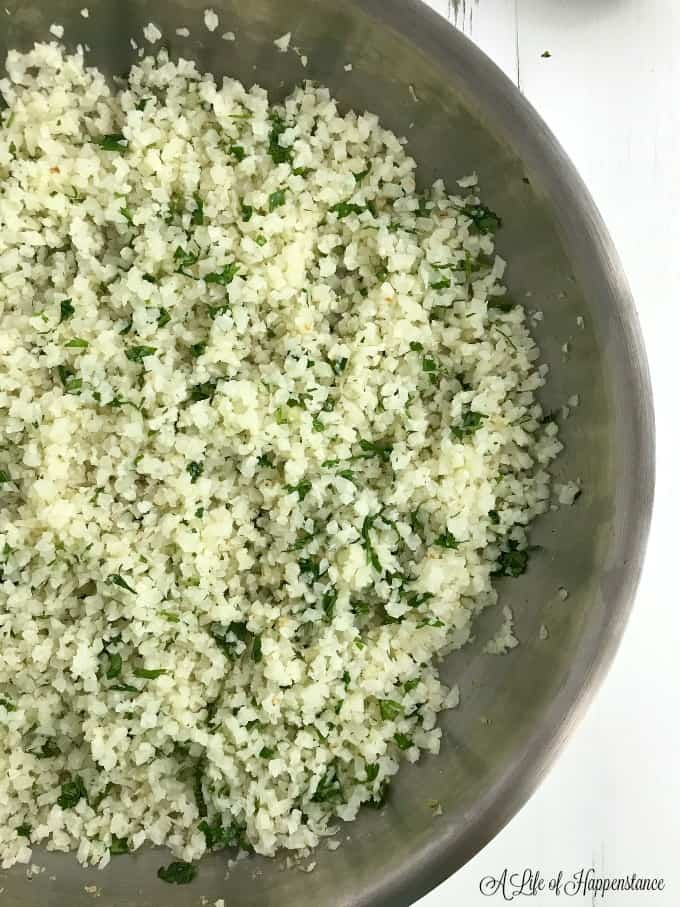 Off centered shot of a skillet filled with cilantro lime cauliflower rice.