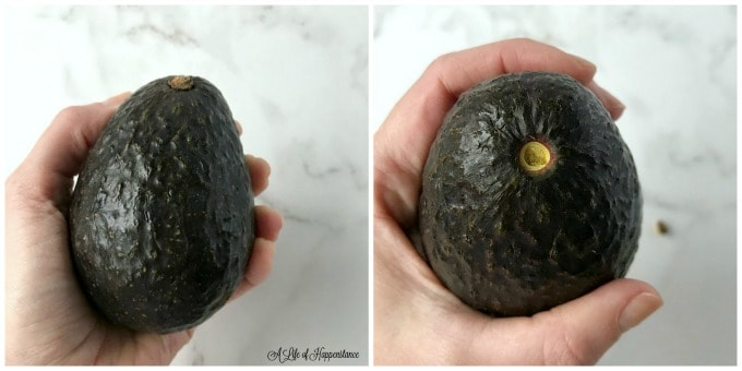 A two photo collage. First photo is a hand holding a haas avocado. second photo shows the top of the avocado with the stem missing.