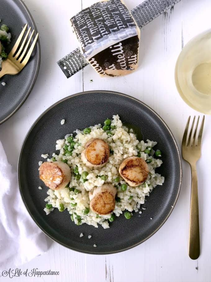 The Seared Scallops with Parmesan Cauliflower Risotto on black plates.