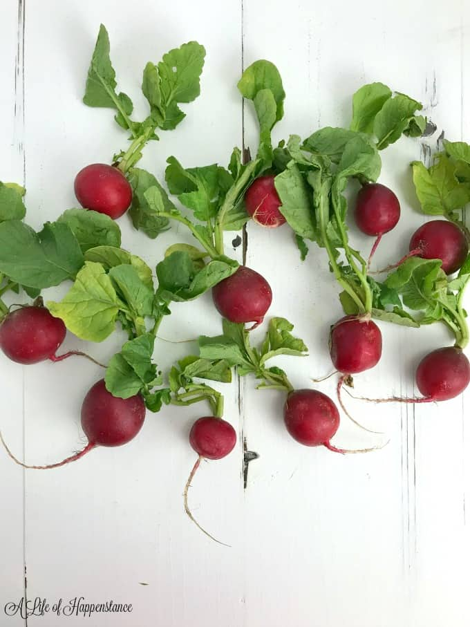 Fresh radishes on a white table.