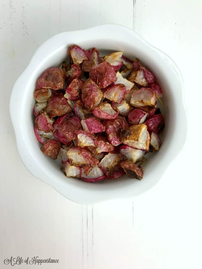 The roasted radishes in a small white bowl.