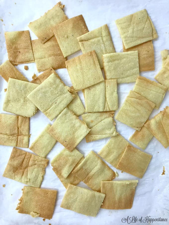 Almond flour crackers on a piece of white parchment paper.