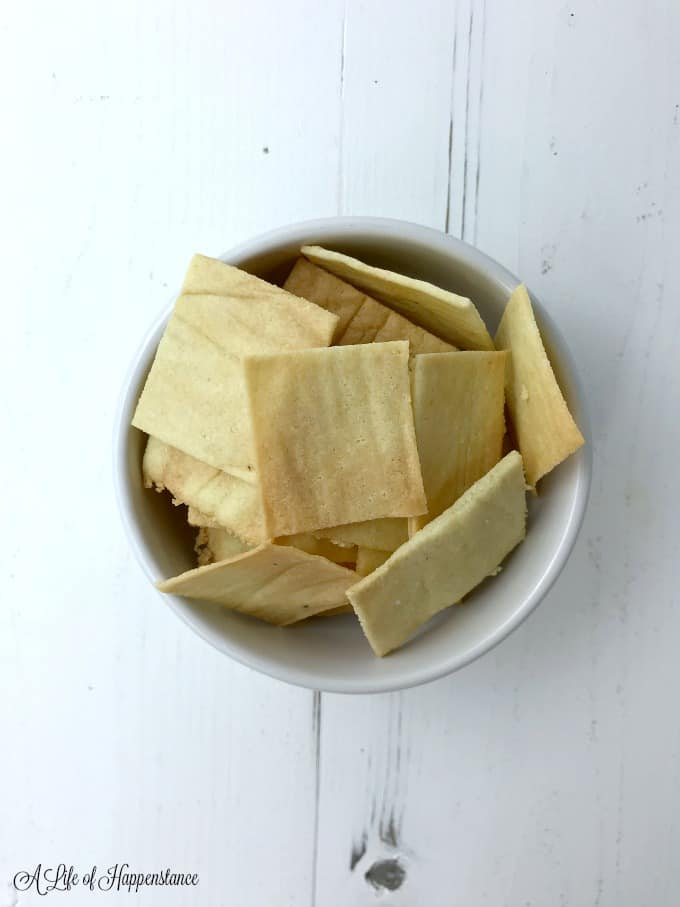 Almond flour crackers in a small white bowl.
