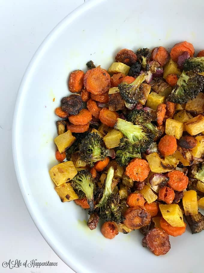 A large white bowl filled with roasted vegetables.