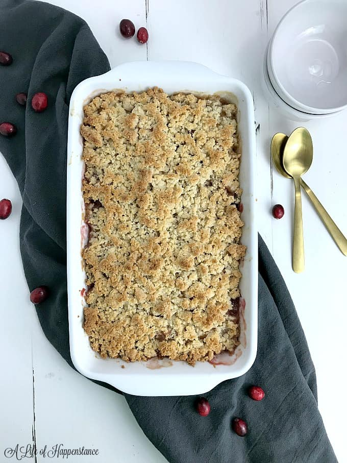A baked cranberry apple crumble in a white baking dish.