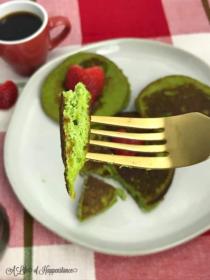 A forkful of Grinch green pancakes.