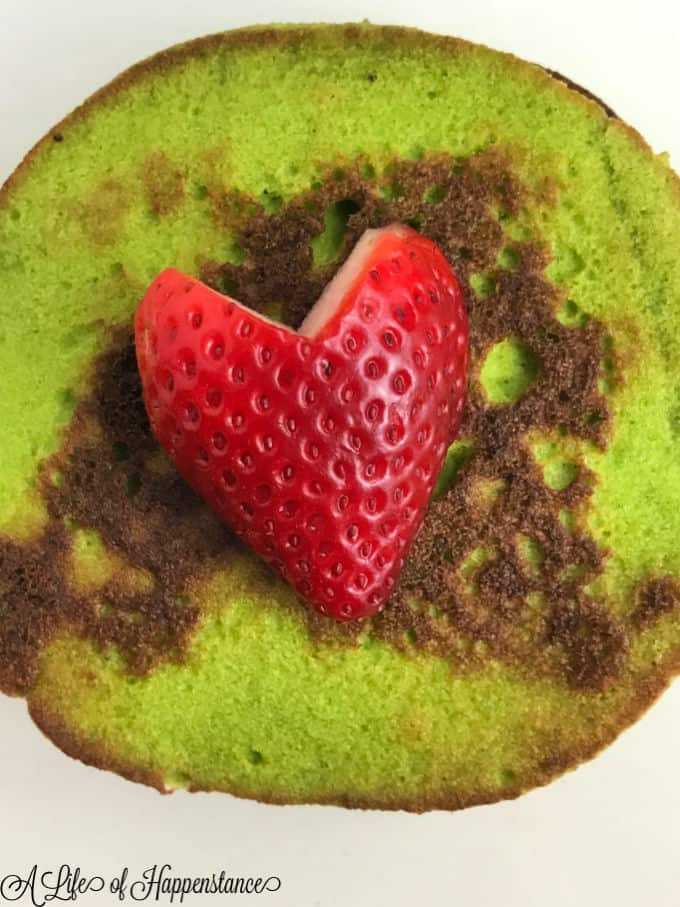 One Grinch green pancake with a strawberry heart.