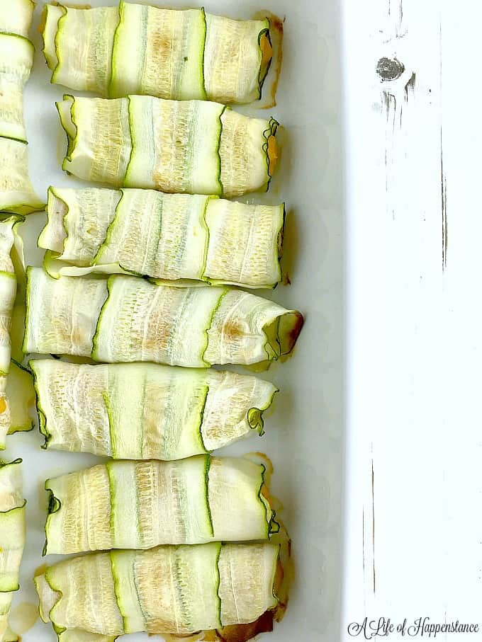 The zucchini cannelloni with butternut squash filling in a white baking dish right out of the oven.
