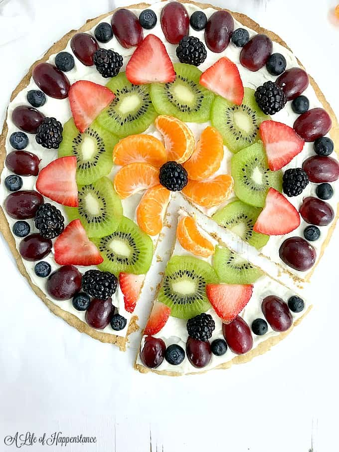 A slice removed from the easy fruit pizza.