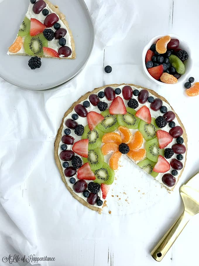 A slice of easy fruit pizza on a plate.