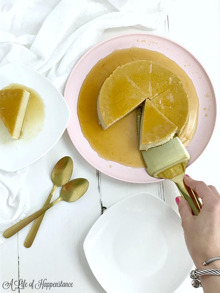 Serving slices of the flan onto white plates.