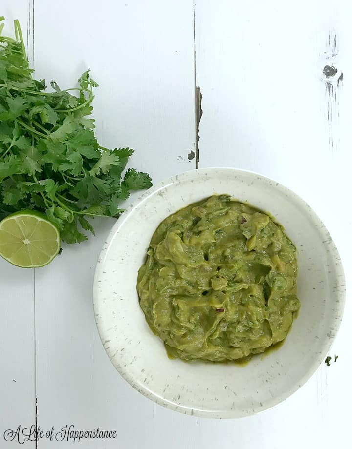 An overhead photo of the broccomole in a white bowl.