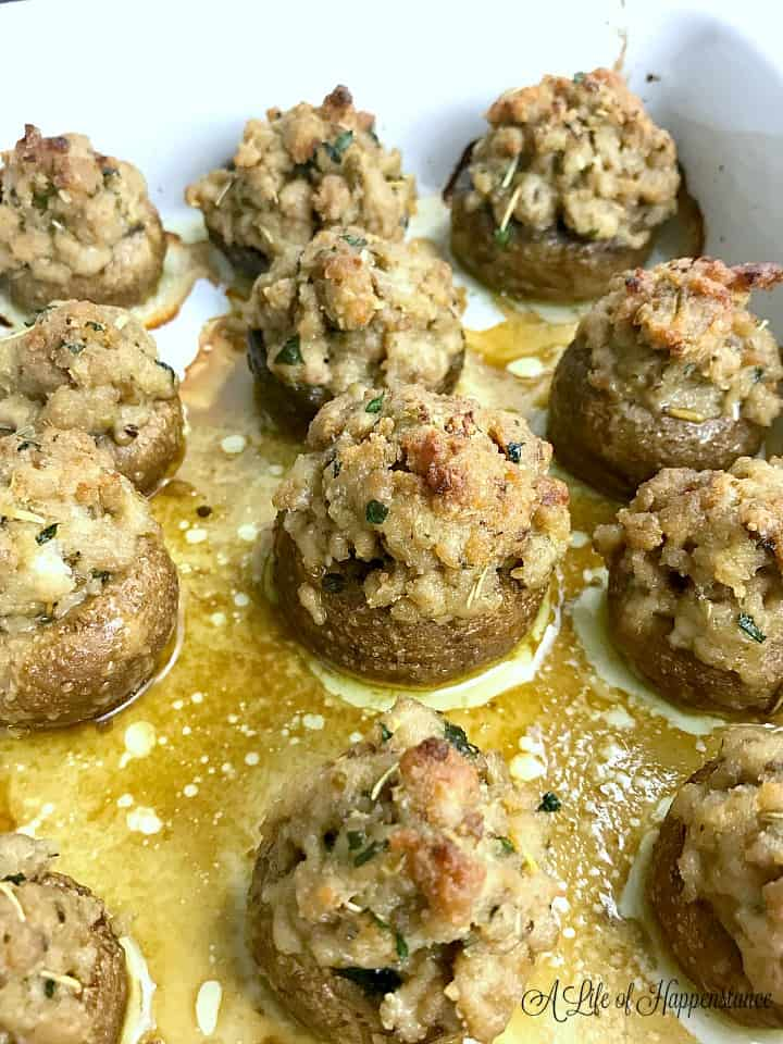 Up close photo of the baked mushrooms in a white baking dish right out of the oven.