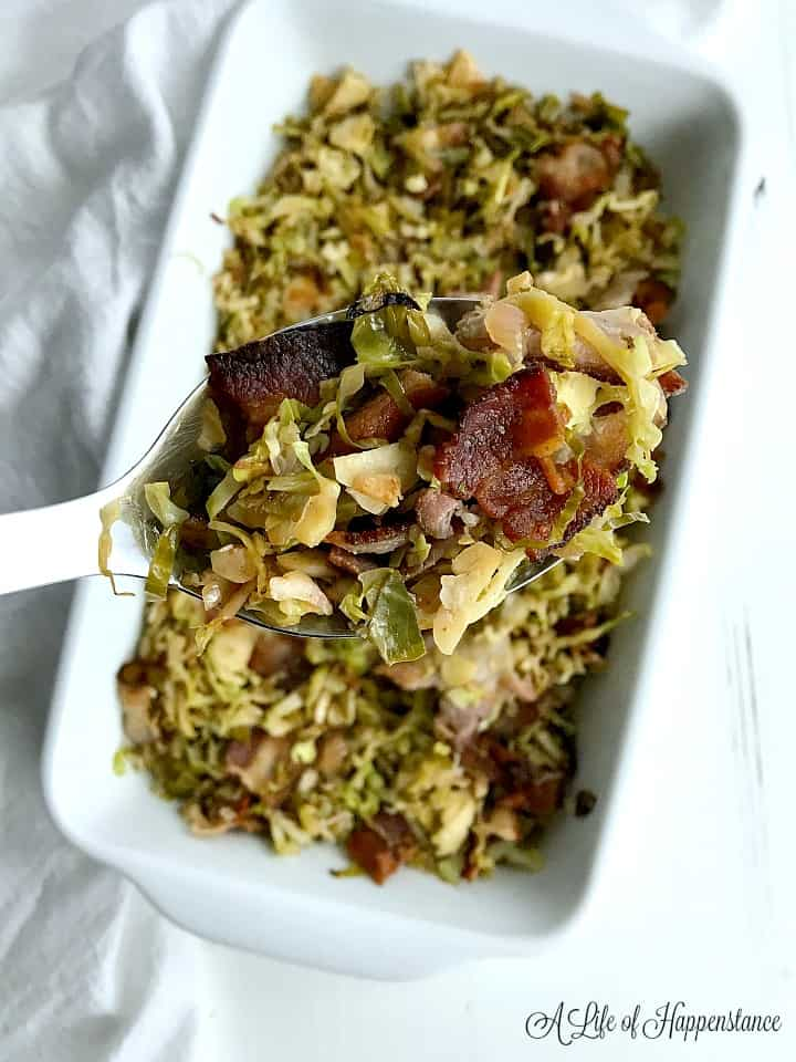 A spoonful of the shaved brussel sprouts with bacon.