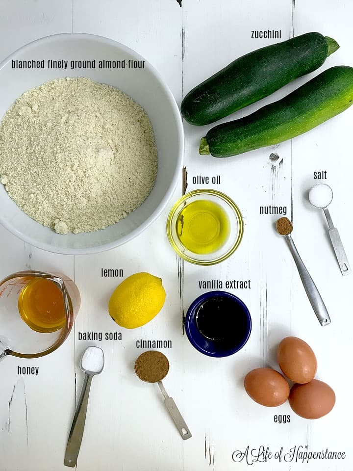 All of the ingredients for the bread on a white table.