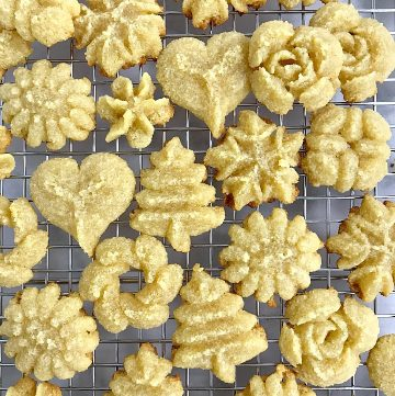 almond flour spritz cookies on a metal cooling rack.