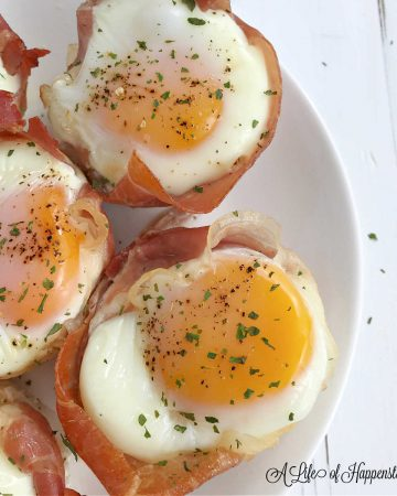 A close up photo of the prosciutto egg bake on a white plate.