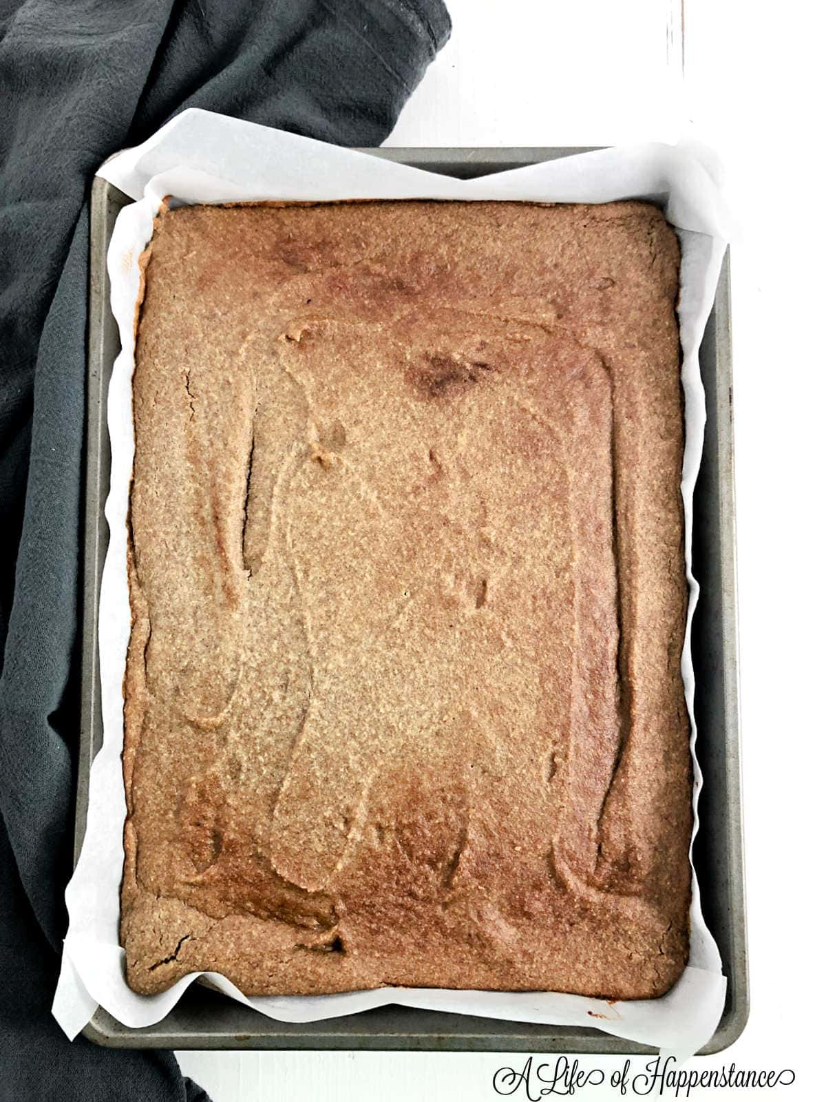 The baked banana cake cooling in the baking pan.